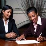 womansigningcontractsmall