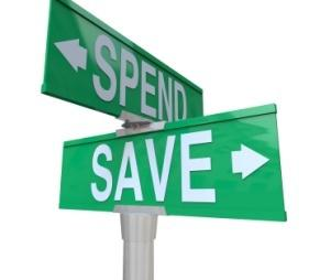 Save Vs Spend Two Way Street Signs Point to Fiscal Responsibility