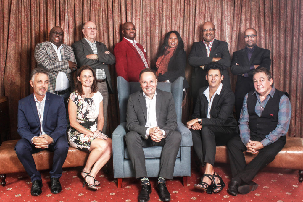 Seated: From left, Pieter Cronje, Fiona Rollason, Wayne Hiller van Rensburg (President), Geraldine Fowler (Vice-President), Anthony Williams Standing: From left, Thomas Maketelwa, Professor Voet Du Plessis, Sonnyboy Msingi ,  Sizakele Khumalo (General Manager, Staff Team), Enos Ngutshane, Mandla Nkosi. (Not pictured, Vusi Mashile) Attached: Individual profiles of each Board Member for reference.